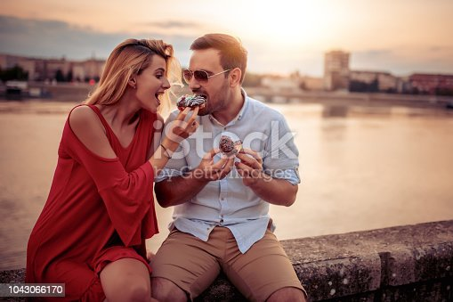 1069131934 istock photo Happy young couple having fun outdoors 1043066170
