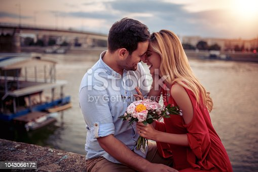 1069131934 istock photo Happy young couple having fun outdoors 1043066172
