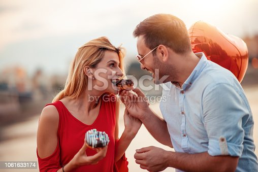1069131934 istock photo Happy young couple having fun outdoors 1061633174