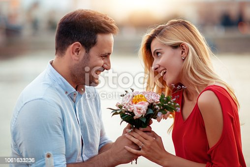 1069131934 istock photo Happy young couple having fun outdoors 1061633236