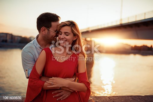 1069131934 istock photo Happy young couple having fun outdoors 1061633520