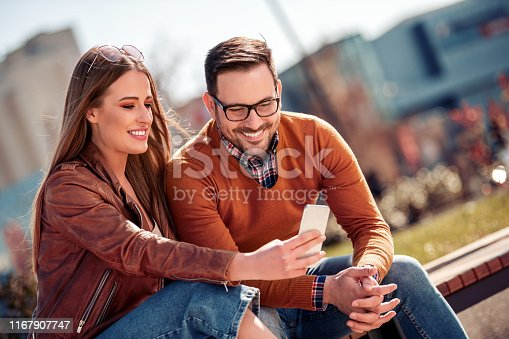 1069131934 istock photo Happy young couple having fun outdoors 1167907747