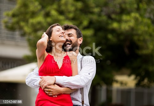 1069131934 istock photo Happy young couple having fun outdoors. 1224246188