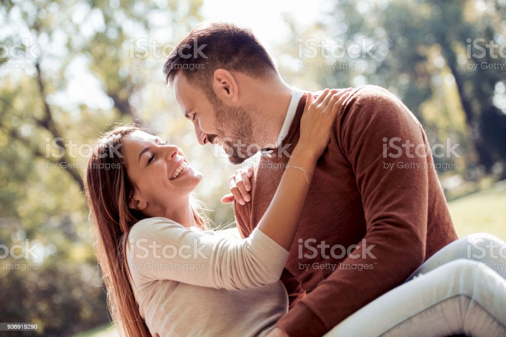 Happy young couple having fun outdoors stock photo