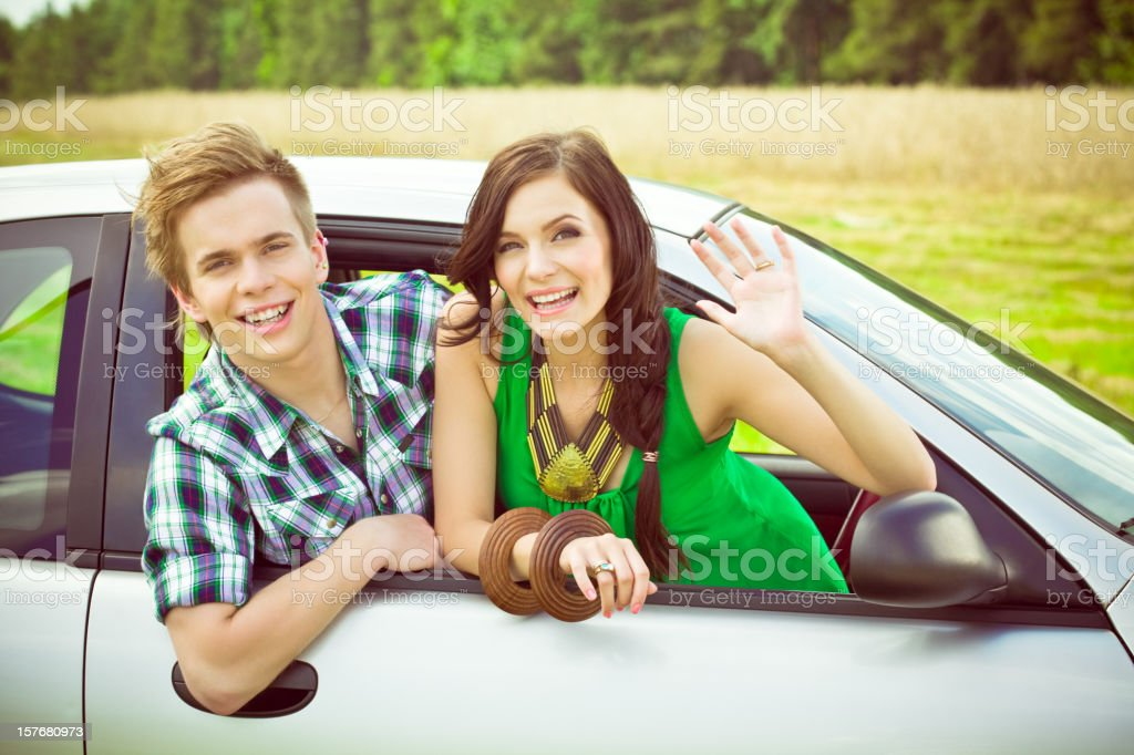 Happy young couple in a car royalty-free stock photo