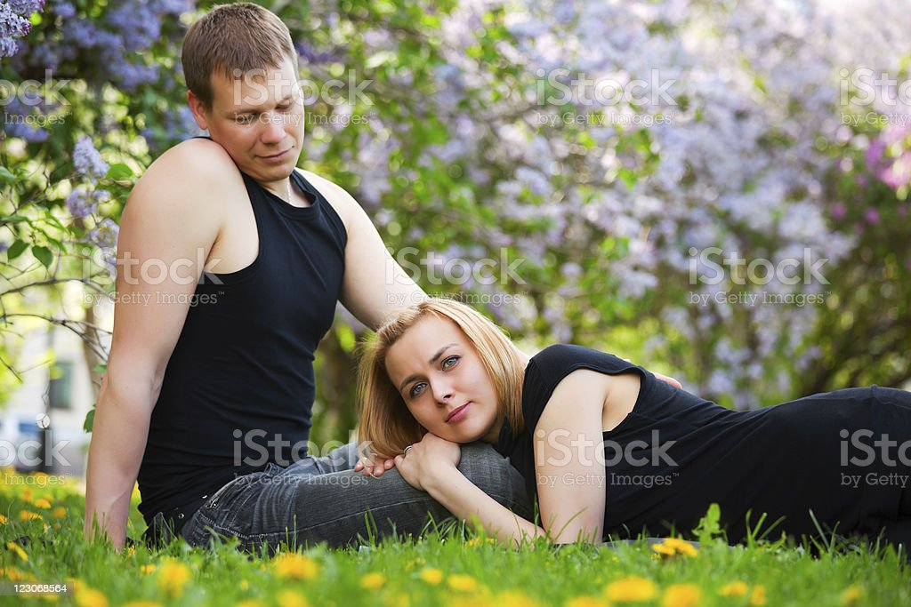 Happy young couple in a city park royalty-free stock photo