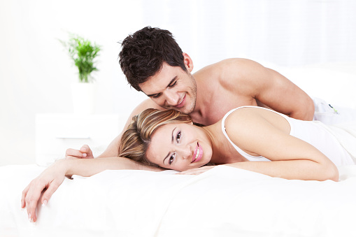 Happy Young Couple In Bed Stock Photo - Download Image Now