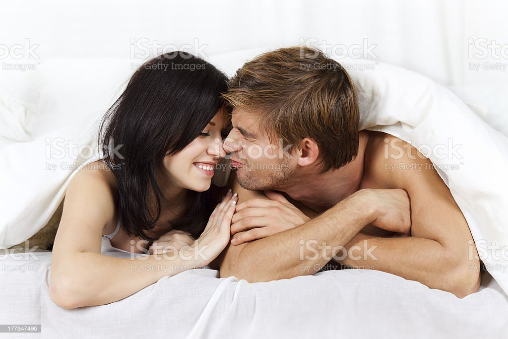 happy young couple in bed royalty-free stock photo