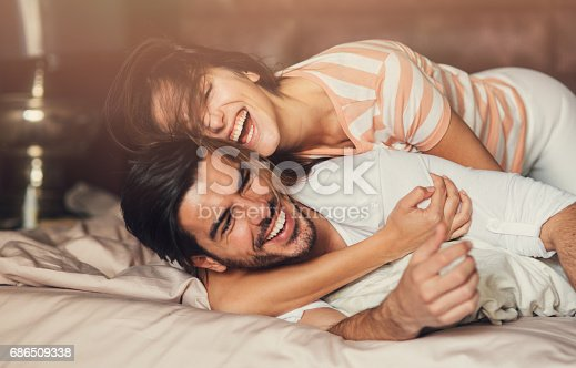 istock Happy young couple in bed 686509338