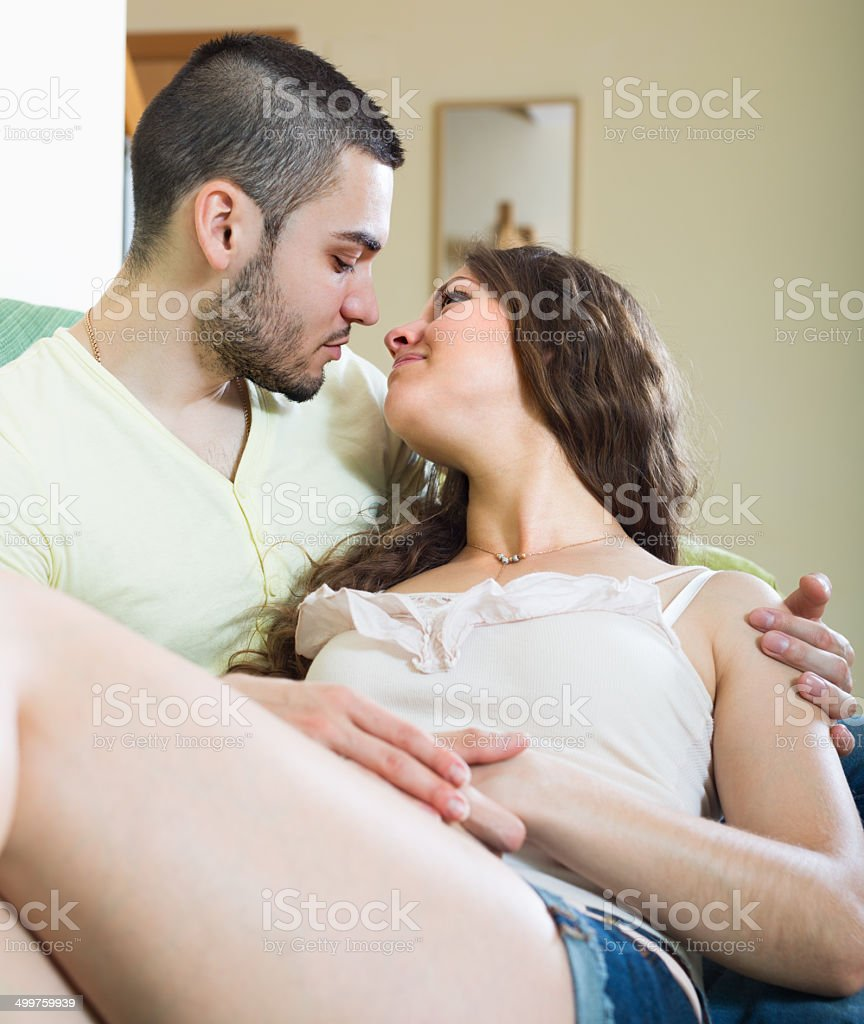 Happy young couple in home interior royalty-free stock photo