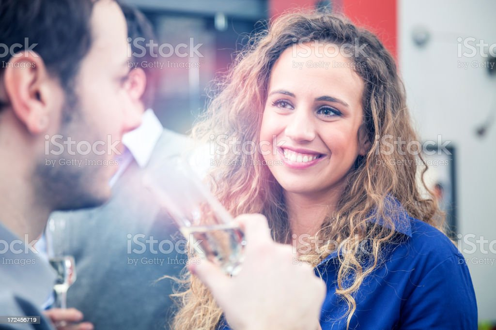 Happy young couple in love drinking together stock photo