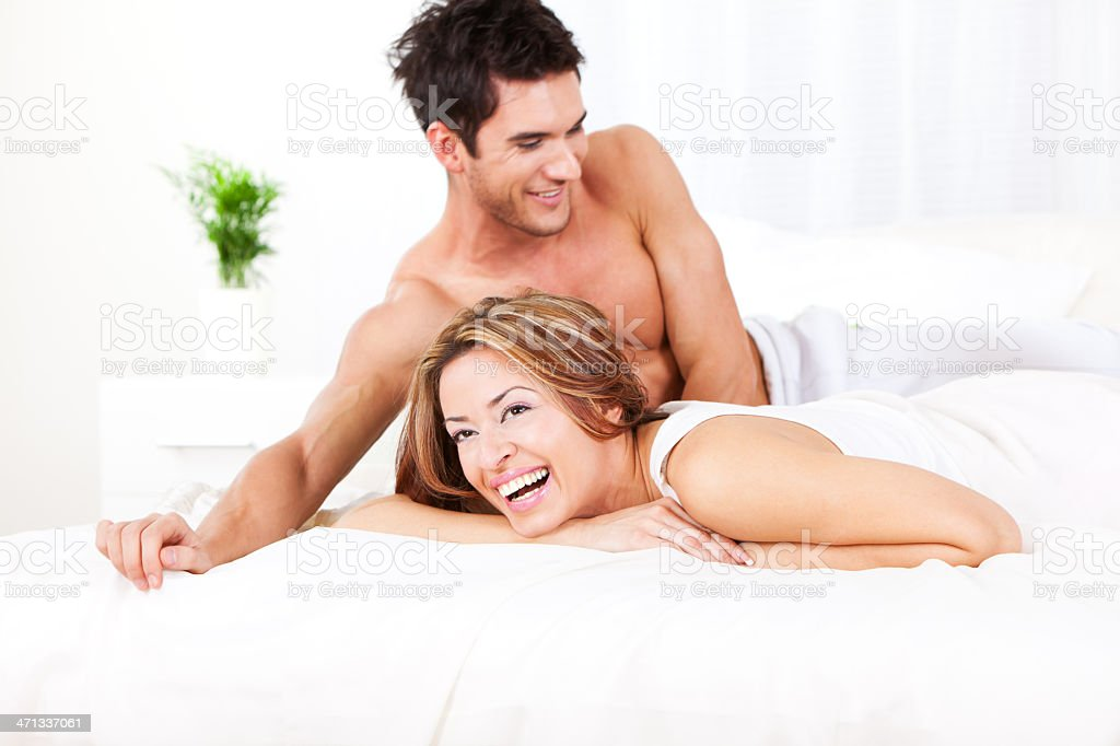 Happy young couple in the bedroom royalty-free stock photo