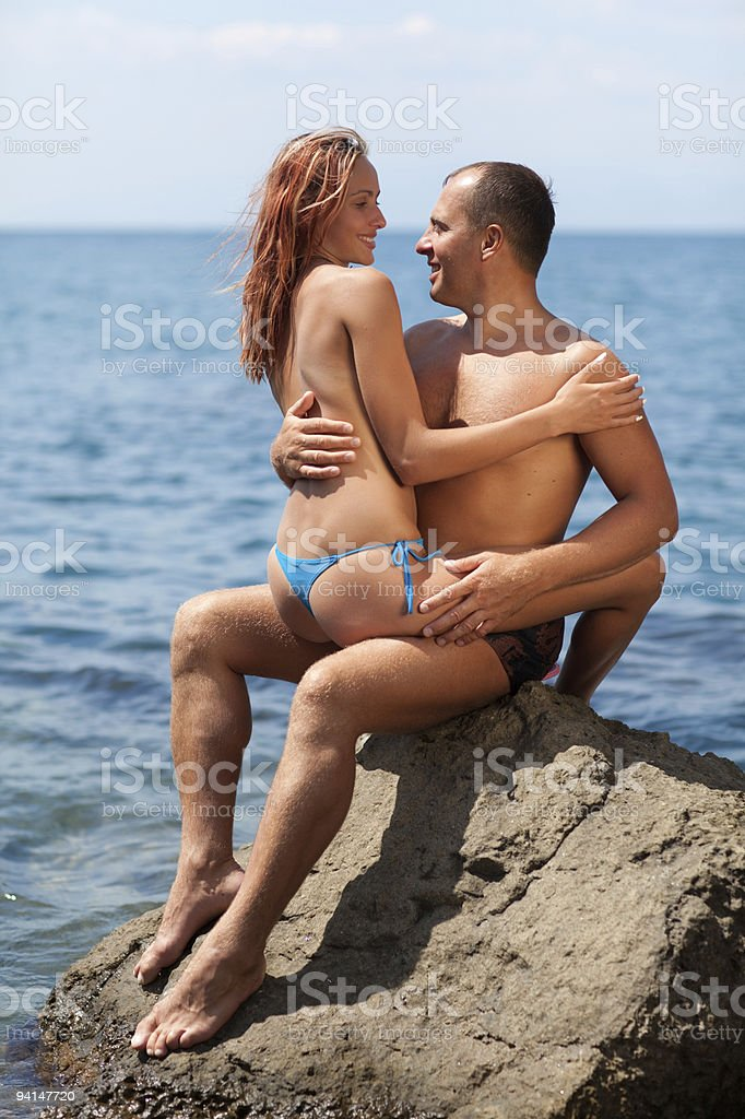 Happy young couple in the sea stock photo