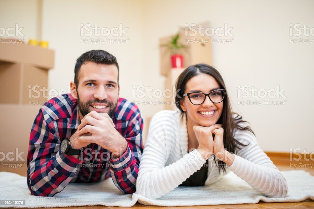 Happy young couple in their new home royalty-free stock photo