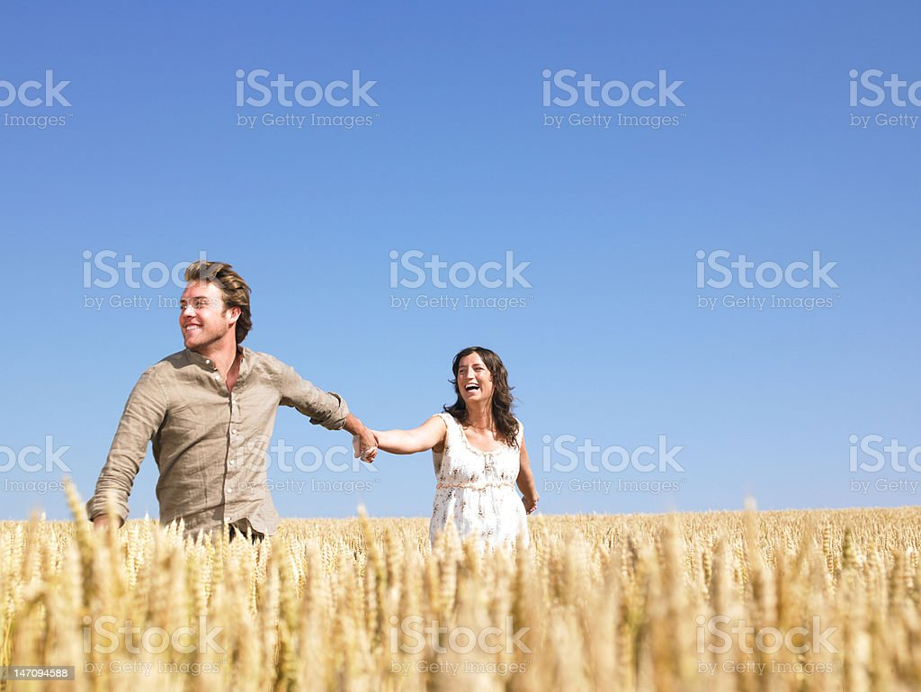 Happy Young Couple in Wheat Field royalty-free stock photo