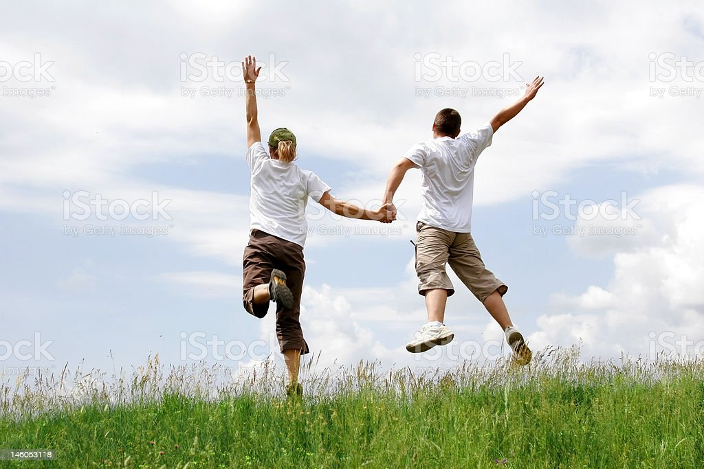 Happy young couple jumping royalty-free stock photo