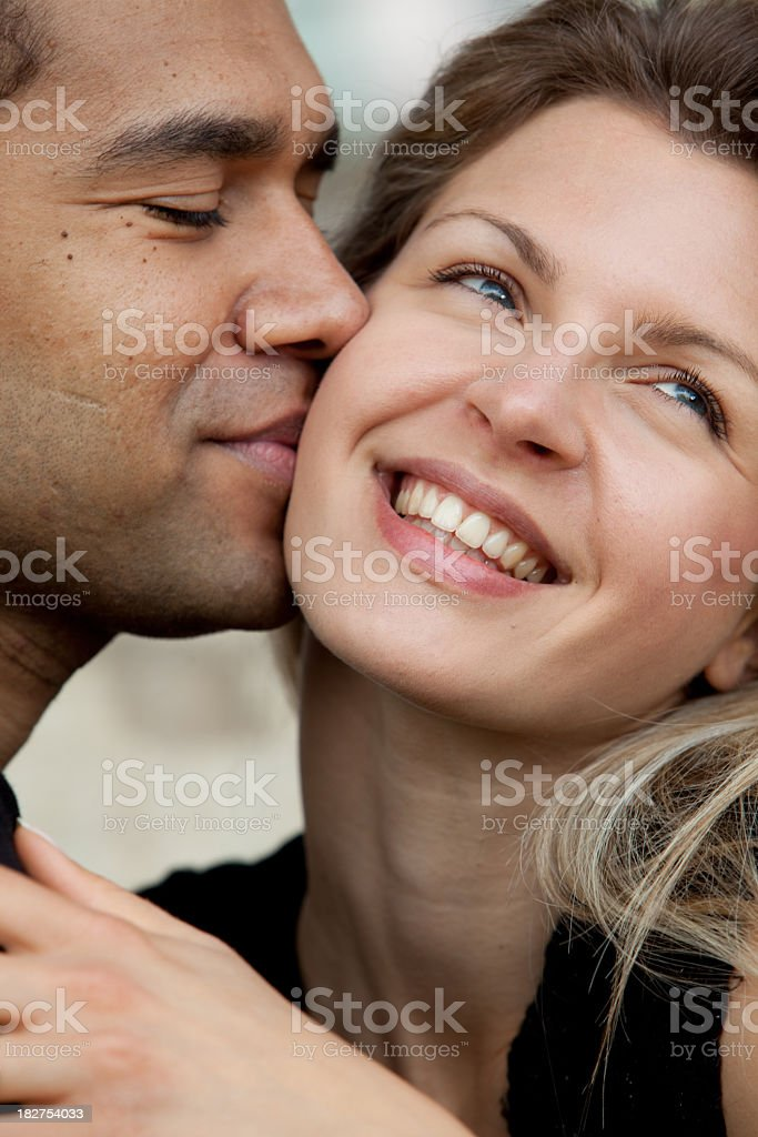 Happy young couple kissing stock photo