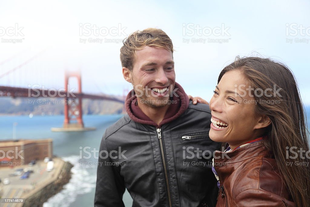 Happy young couple laughing, San Francisco stock photo