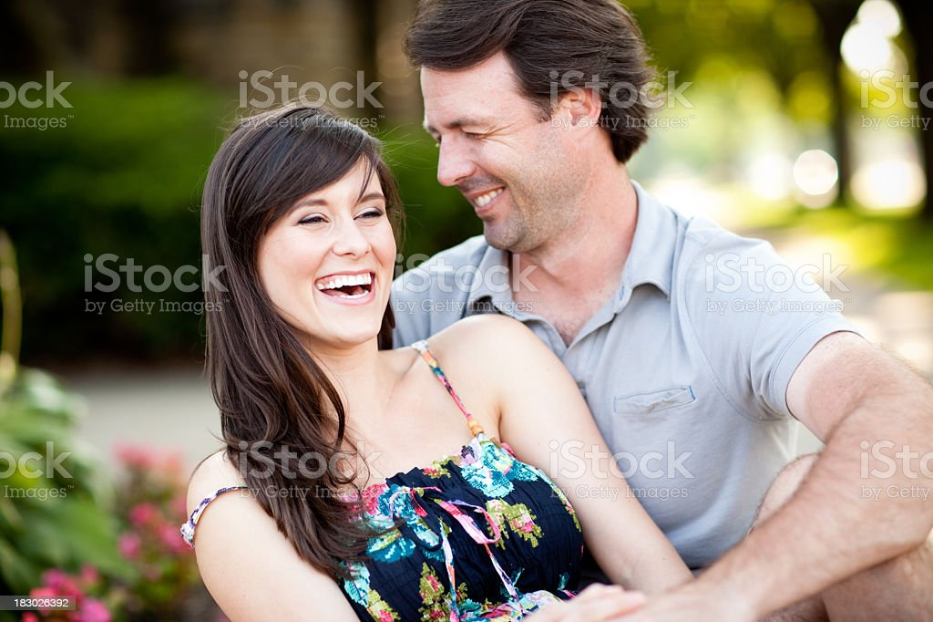Happy Young Couple Laughing Together Outside stock photo