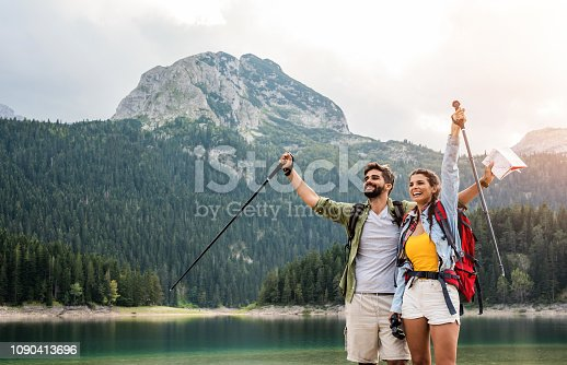 Happy young couple love hiking together.