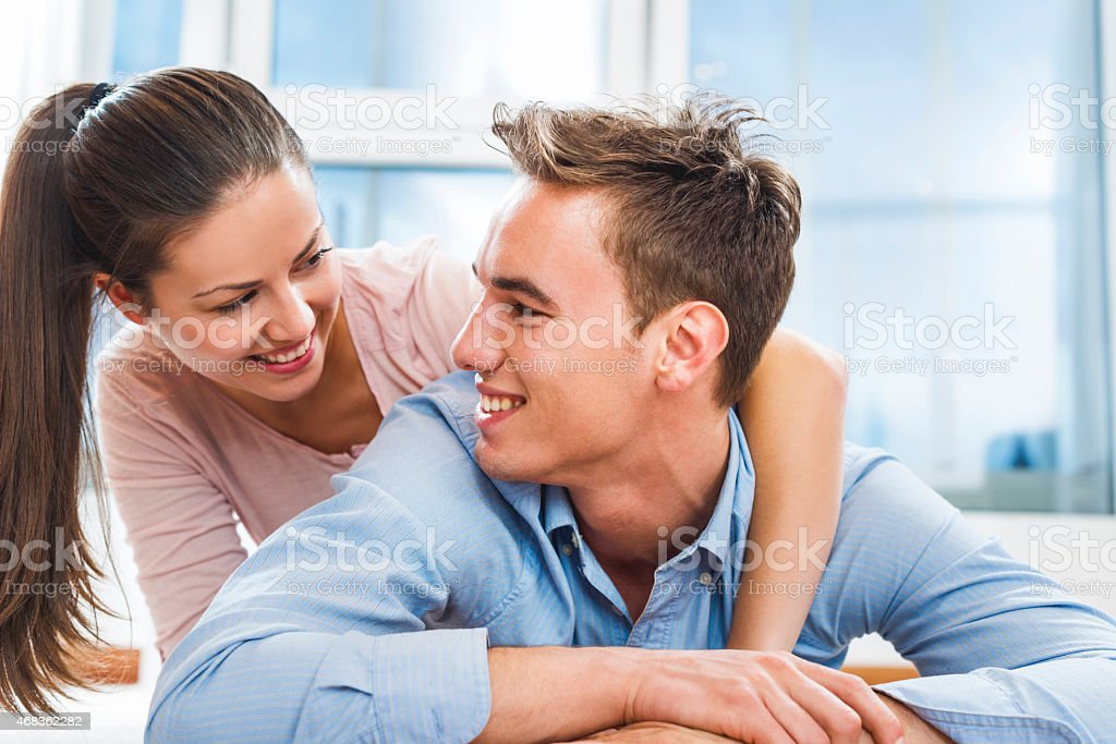 Happy young couple lying down and talking. royalty-free stock photo