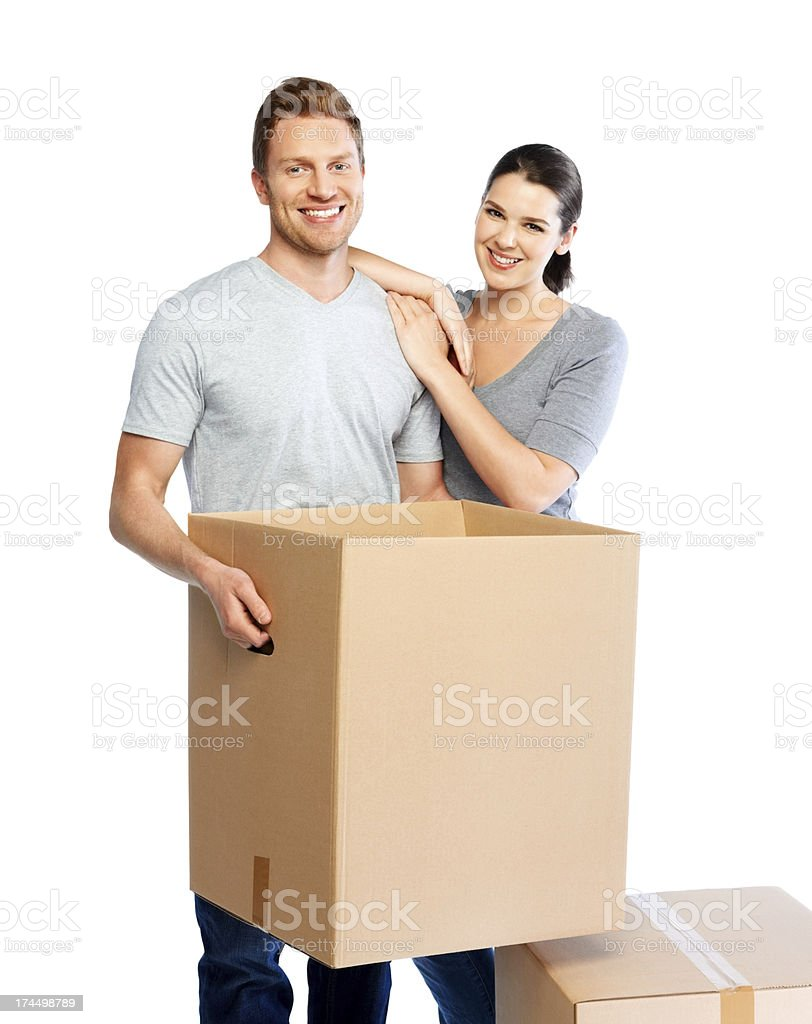 Happy young couple moving big boxes royalty-free stock photo