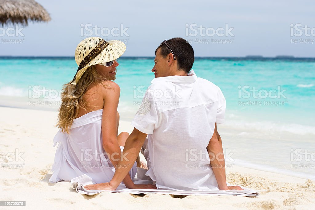 Happy young couple on a beach stock photo