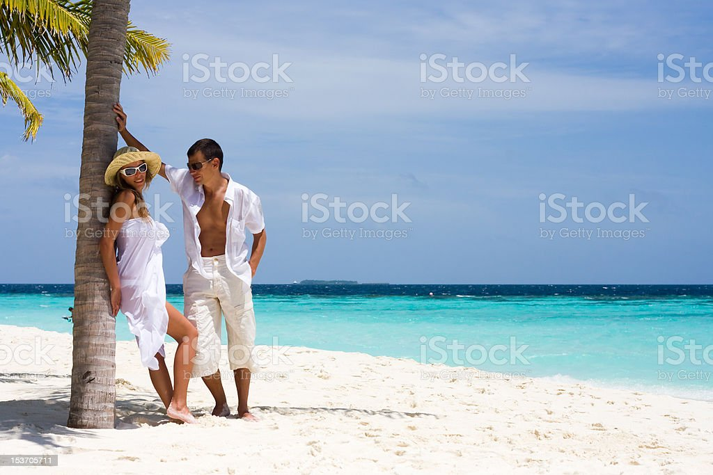 Happy young couple on a beach royalty-free stock photo