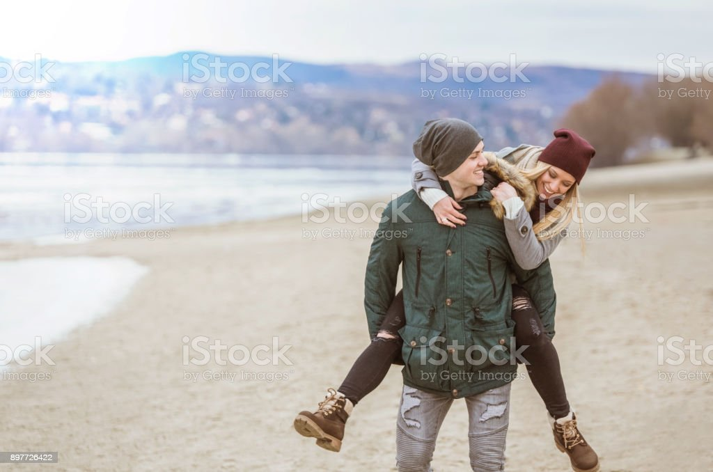 Happy young couple on a winter day. stock photo