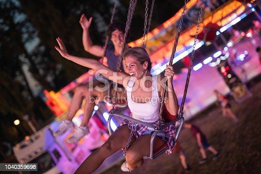 Two friends having fun in amusement park.