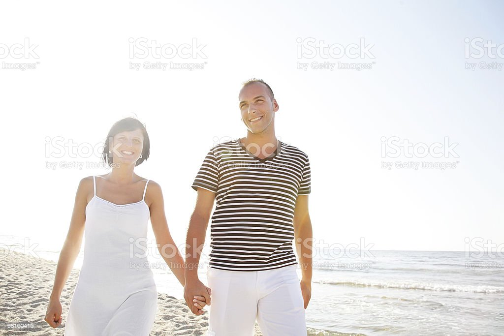 Happy young couple on the beach royalty-free stock photo