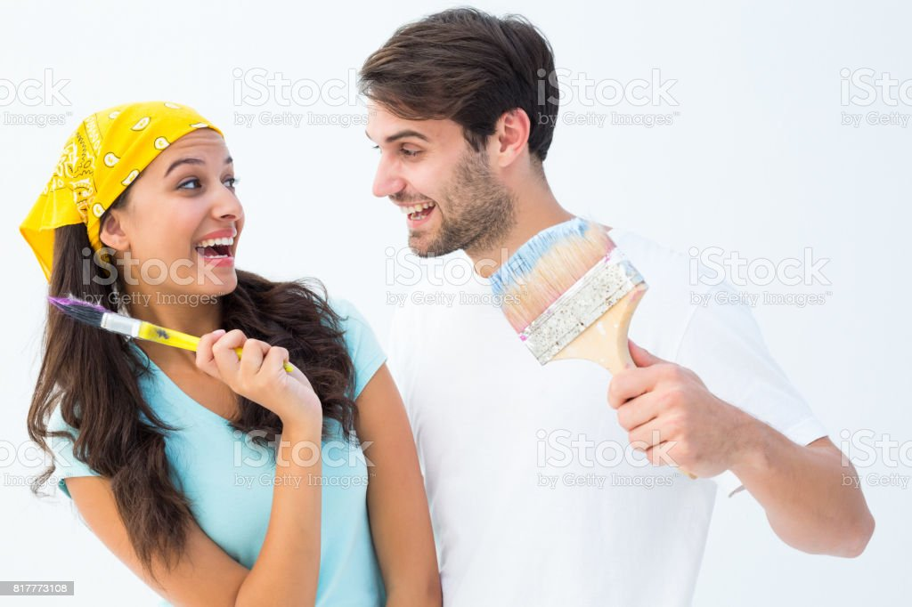 Happy Young Couple Painting Together And Laughing Royalty Free Stock Photo