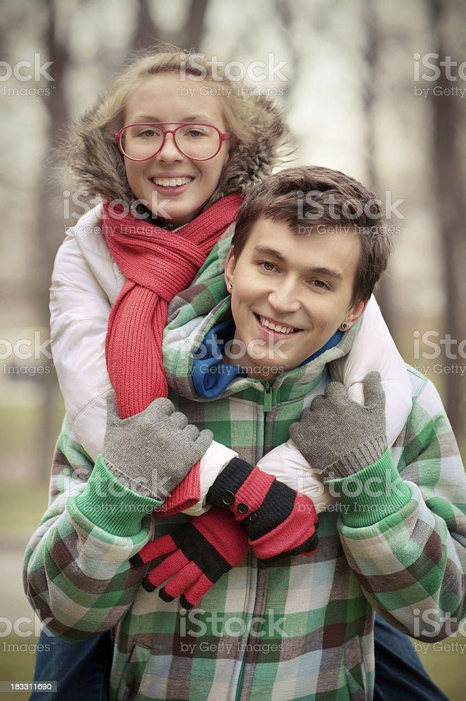 Happy young couple. Piggyback. stock photo