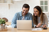 istock Happy young couple planning budget, reading good news 1224986960