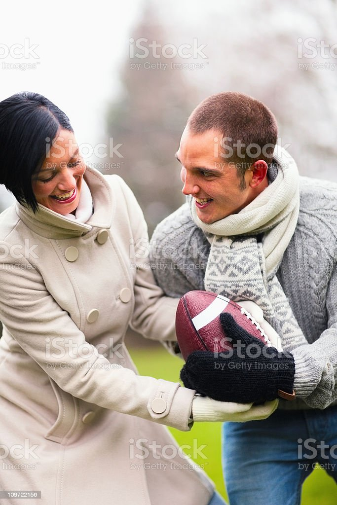 Happy young couple playing outdoors royalty-free stock photo
