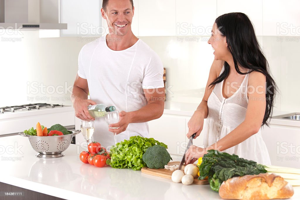 Happy young couple preparing food royalty-free stock photo