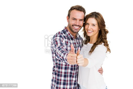 673176670 istock photo Happy young couple putting thumbs up 673177266