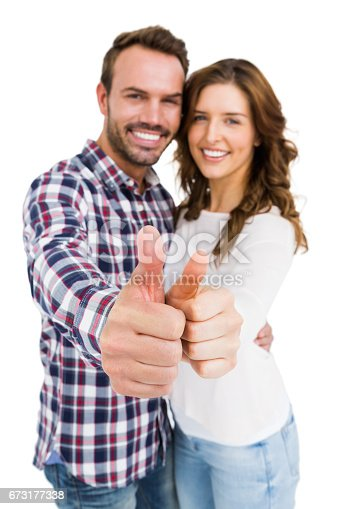 673176670 istock photo Happy young couple putting thumbs up 673177338