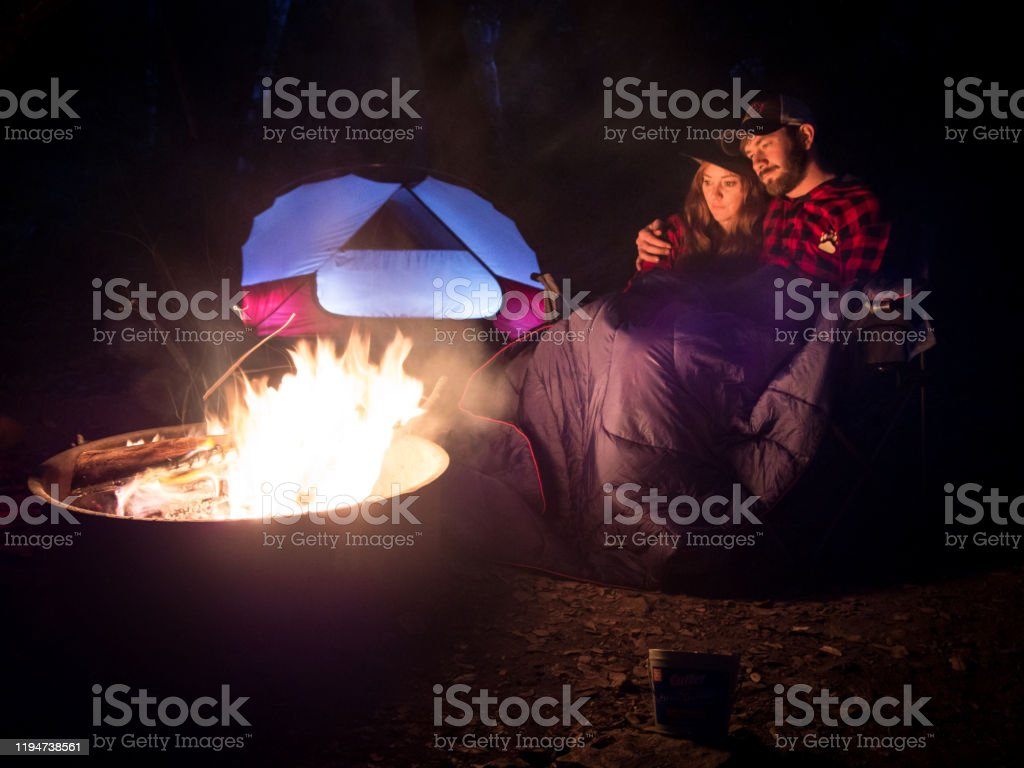 Happy Young Couple Relax By A Warm Fire At Night Stock Photo Download Image Now Istock