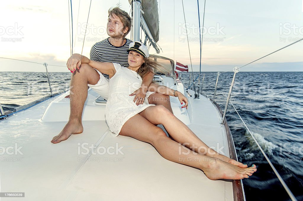 Happy young couple relaxing on a yacht royalty-free stock photo