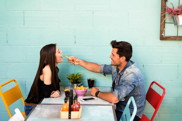 Happy young couple seating in a restaurant stock photo
