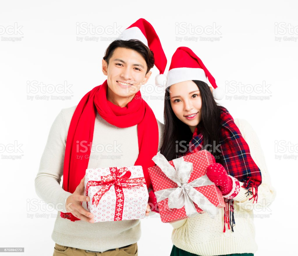 happy young couple showing christmas gifts royalty free stock photo