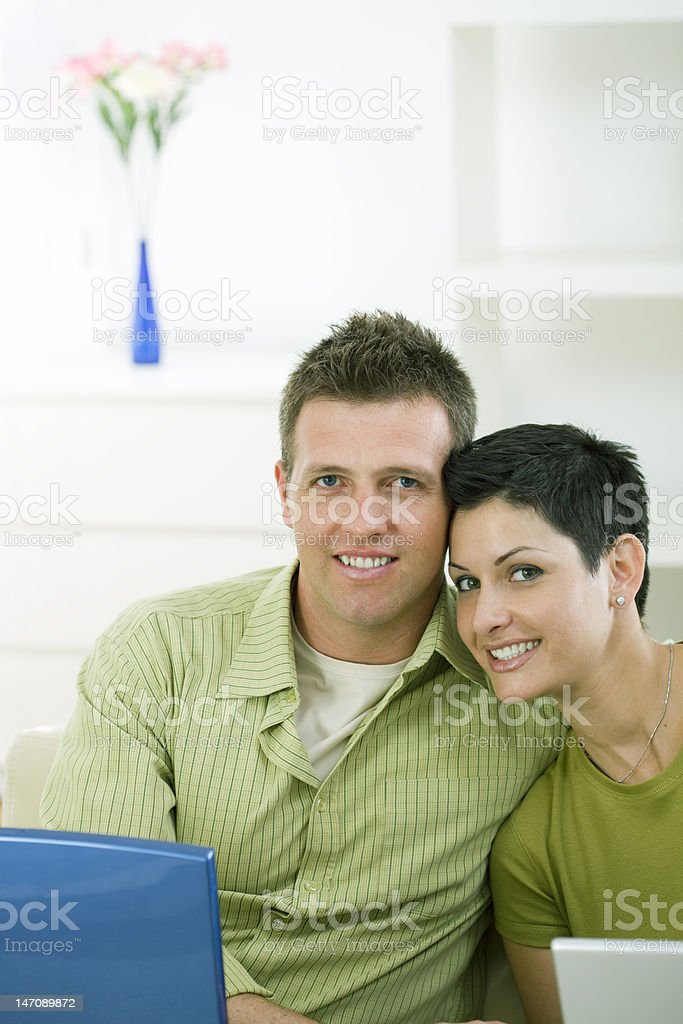 Happy young couple sitting in the living room royalty-free stock photo