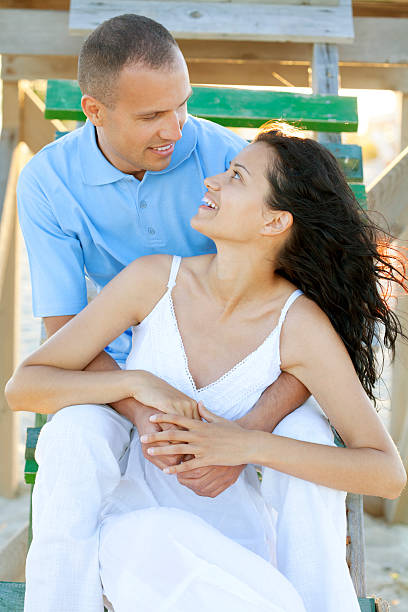 happy young couple sitting outdoor stock photo