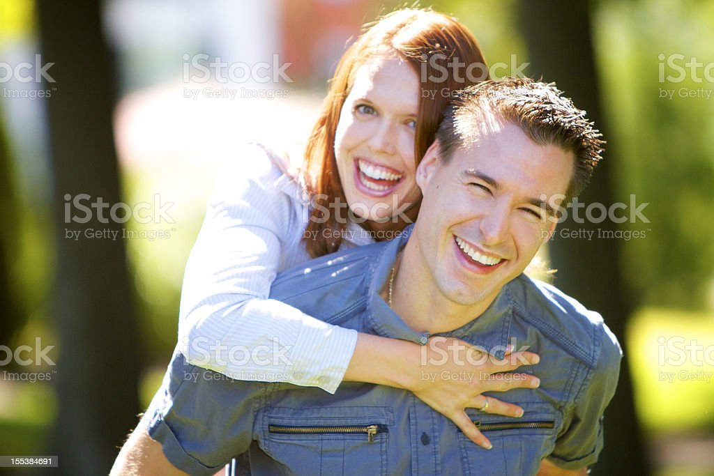 Happy young couple smiling at the camera stock photo