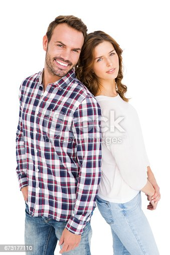 673176670 istock photo Happy young couple standing back to back 673177110