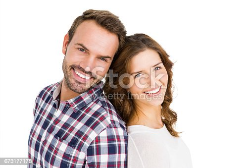 673176670 istock photo Happy young couple standing back to back 673177178