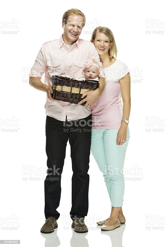 Happy young couple standing with their child royalty-free stock photo