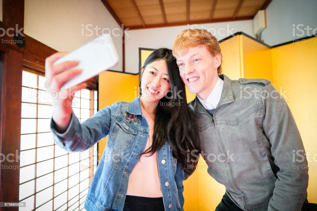 Happy Young couple to enjoy the tourism Kyoto royalty-free stock photo