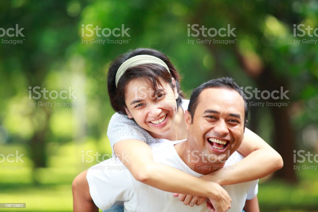 happy young couple together in the garden royalty-free stock photo